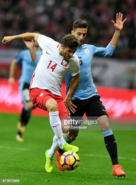 Poland's Bartosz Bereszynski and Uruguay's Rodrigo Bentancur vie for the ball during their international friendly football match between Poland and...