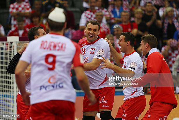 Poland's Bartosz Jurecki celebrates their win with team mates during the 24th Men's Handball World Championships quarterfinals match between Poland...