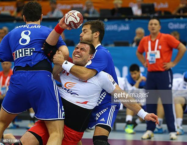 Poland's Bartosz Jurecki fights for the ball during the 24th Men's Handball World Championships quarterfinals match between Poland and Croatia at the...