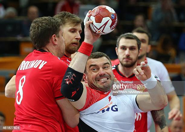 Poland's Bartosz Jurecki fights with Russia's Egor Evdokimov the ball during the 24th Men's Handball World Championships preliminary round Group D...