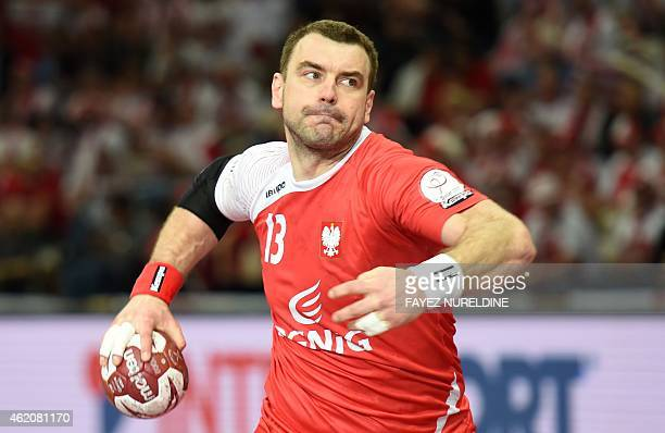 Poland's Bartosz Jurecki passes the ball during the 24th Men's Handball World Championships preliminary round Group D match between Russia and...