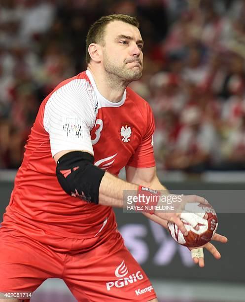 Poland's Bartosz Jurecki passes the ball during the 24th Men's Handball World Championships preliminary round Group D match between Denmark and...