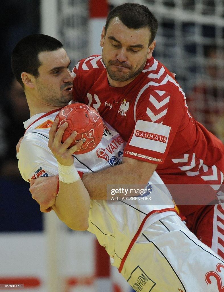 Poland's Bartosz Jurecki (R) vies with Macedonia's Filip Lazarov (L) during the men's EHF Euro 2012 Handball Championship match Poland vs Macedonia on January 23, 2012 at the Belgrade Arena.