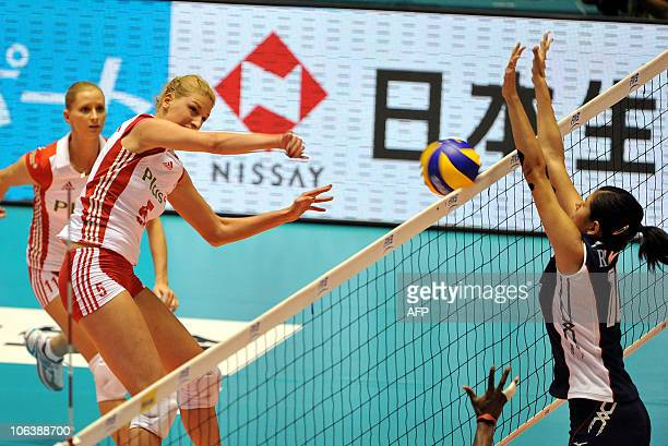 Poland's Berenika Okuniewska spikes the ball to Paola Ramirez Vargas of Costa Rica during the first round of the world woman's volleyball...