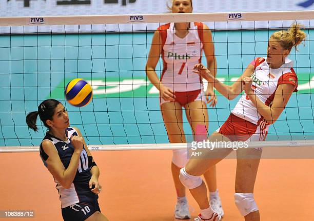 Poland's Berenika Okuniewska watches the ball after spiking to Paola Ramirez Vargas of Costa Rica during the first round of the world woman's...