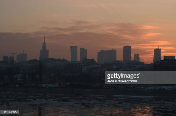 Poland's capital Warsaw is shrouded in a thick layer of smog on January 9 2017 as coal and wastefired home furnaces drive up air pollution to the...