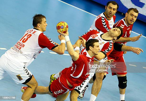 Poland's centre back Bartlomiej Jaszka shoots past Serbia's left back Momir Ilic and Serbia's centre back Nenad Vuckovic during the 23rd Men's...