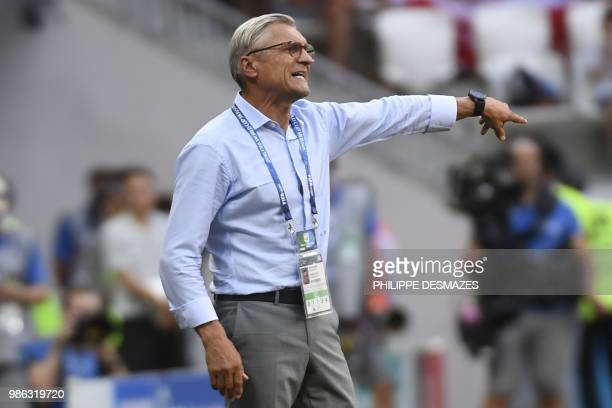 Poland's coach Adam Nawalka gestures during the Russia 2018 World Cup Group H football match between Japan and Poland at the Volgograd Arena in...