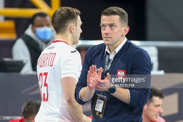 Poland's coach Patryk Rombel encourages his team during the 2021 World Men's Handball Championship between Group I teams Uruguay and Poland at the...