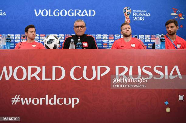 Poland's coach Polish Adam Nawalka and players Bartosz Bereszynski Jakub Blaszczykowski and Grzegorz Krychowiak attend a press conference at the...
