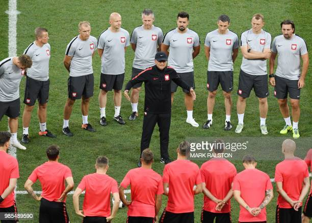 Poland's coach Polish Adam Nawalka speaks with players during a training session at the Volgograd arena in Volgograd on June 27 2018 on the eve of...