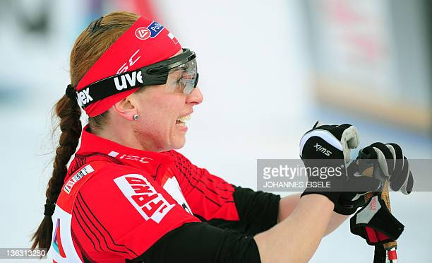 Poland's cross country skier Justyna Kowalczyk reacts after placing second in the women's Tour de Ski skiathlon 5 km Classic 5 km Freestyle event on...