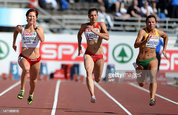Poland's Daria Korczynska Bulgaria's Gabriela Laleva and Lithuania's Lina Grincikaite compete in the women's 100m qualifications of the 2012 European...