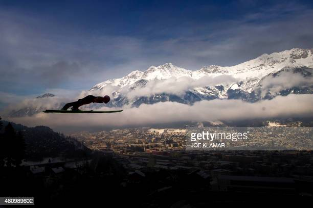 Poland's David Kubacki soars through the air during a training session of the Four Hills competition of the FIS Ski Jumping World Cup in Innsbruck on...