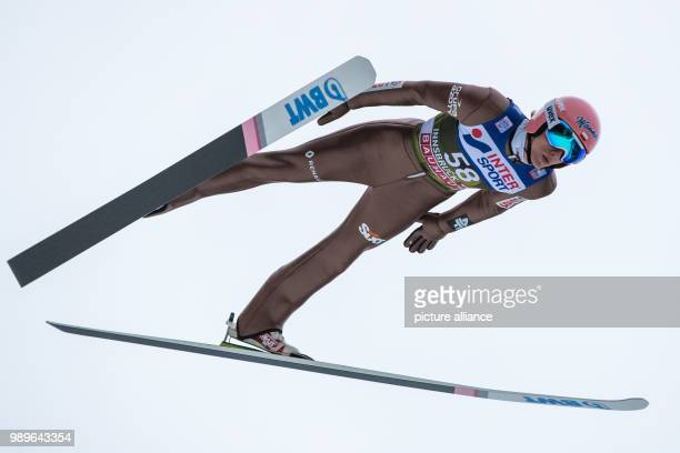 Poland's Dawid Kubacki in action during the qualification run at the Four Hills Tournament in Innsbruck Austria 03 January 2018 Photo Daniel...