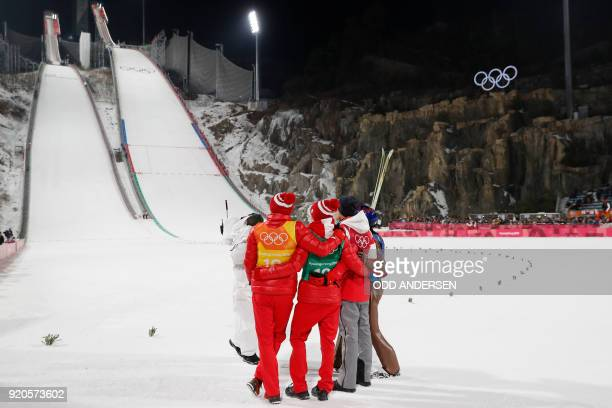 Poland's Dawid Kubacki Poland's Stefan Hula Poland's Maciej Kot and Poland's Kamil Stoch stand together as they wait for thefinal score in the men's...