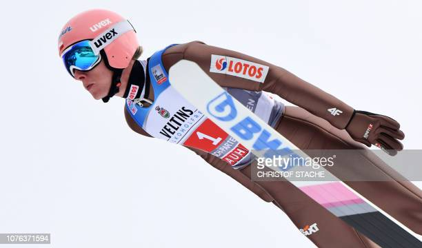 Poland's Dawid Kubacki soars through the air during his training jump at the second stage of the Four-Hills Ski Jumping tournament , in...