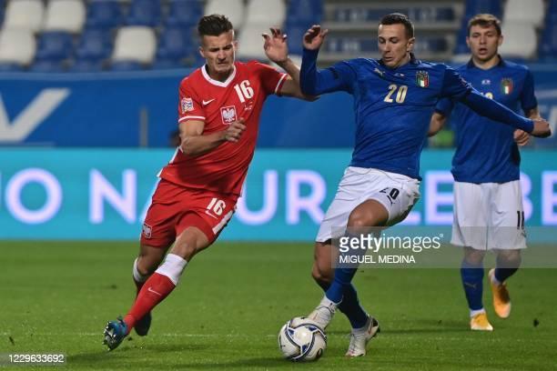 Poland's defender Arkadiusz Reca and Italy's forward Federico Bernardeschi go for the ball during the UEFA Nations League A, Group 1 football match...