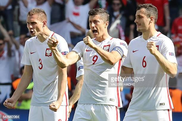 Poland's defender Artur Jedrzejczyk Poland's forward Robert Lewandowski and Poland's midfielder Tomasz Jodlowiec react after Poland's midfielder...