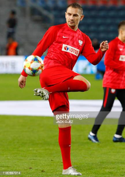 Poland's defender Artur Jedrzejczyk practices with a ball ahead of the EURO 2020 group G qualifiers football match between Israel and Poland at the...