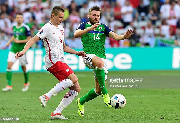 Poland's defender Artur Jedrzejczyk vies with Northern Ireland's midfielder Stuart Dallas during the Euro 2016 group C football match between Poland...