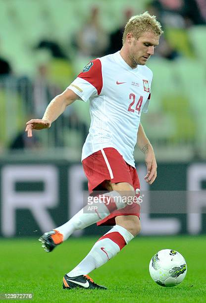 Poland's defender Damien Perquis runs with the ball during the International friendly football match Poland vs Germany in the northern Polish city of...