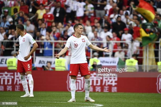 Poland's defender Jan Bednarek and Poland's midfielder Piotr Zielinski react after Senegal scored its second goal during the Russia 2018 World Cup...