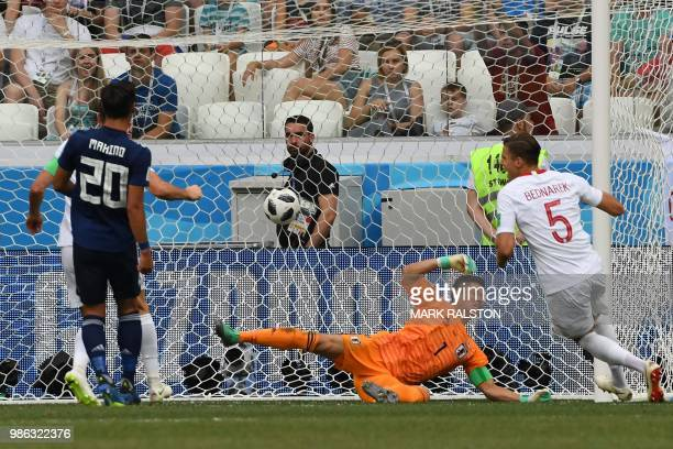 Poland's defender Jan Bednarek celebrates after scoring the opener past Japan's goalkeeper Eiji Kawashima during the Russia 2018 World Cup Group H...