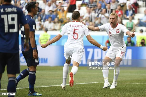 TOPSHOT Poland's defender Jan Bednarek celebrates with Poland's defender Kamil Glik after scoring the opener during the Russia 2018 World Cup Group H...