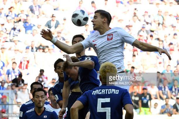 TOPSHOT Poland's defender Jan Bednarek heads the ball during the Russia 2018 World Cup Group H football match between Japan and Poland at the...