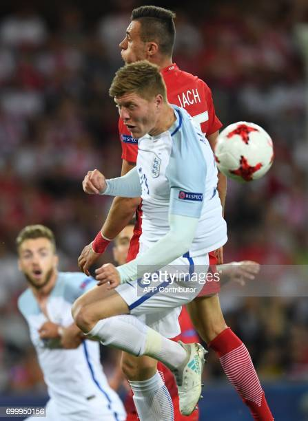Poland's defender Jaroslaw Jach and England's defender Alfie England's defender Alfie Mawson vie for the ball during the UEFA U21 European...