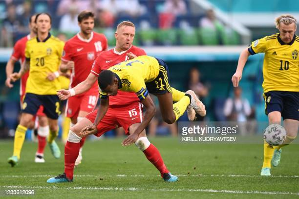 Poland's defender Kamil Glik fights for the ball with Sweden's forward Alexander Isak during the UEFA EURO 2020 Group E football match between Sweden...
