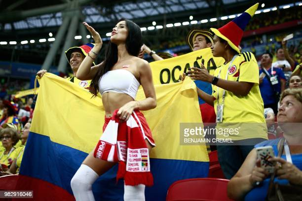 A Poland's fan poses with Colombia's fans before the Russia 2018 World Cup Group H football match between Poland and Colombia at the Kazan Arena in...