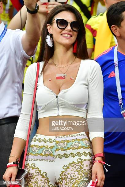 A Poland's fan smiles before the Russia 2018 World Cup Group H football match between Poland and Colombia at the Kazan Arena in Kazan on June 24 2018...