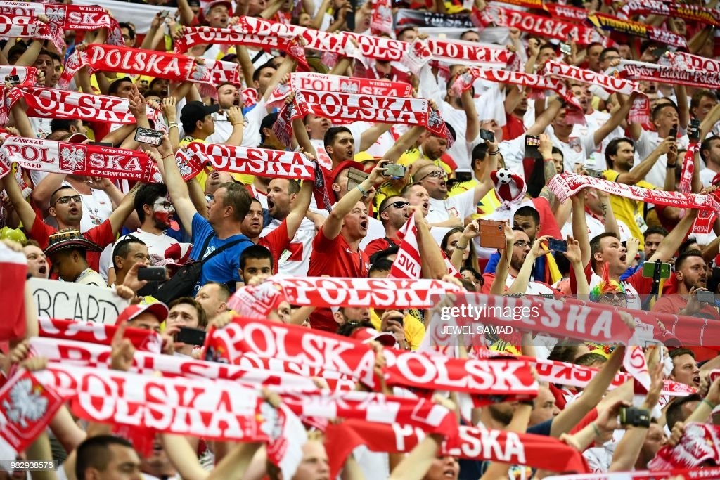 Poland's fans cheer before the Russia 2018 World Cup Group H football match between Poland and Colombia at the Kazan Arena in Kazan on June 24, 2018. (Photo by Jewel SAMAD / AFP) / RESTRICTED