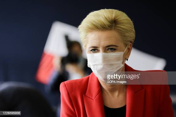 Poland's First Lady Agata KornhauserDuda seen wearing a surgical mask at the polling station The incumbent President of Poland Andrzej Duda with...