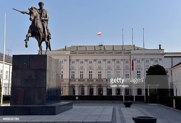 Polands flag flies at halfmast on March 19 2015 outside the Presidential Palace in Warsaw Poland The flag was lowered to halfmast to honour those who...