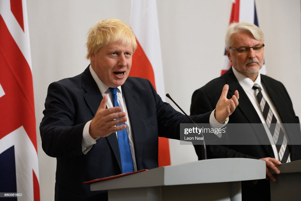 Poland's Foreign Minister Witold Waszczykowski (R) looks on as Britain's Foreign Secretary Boris Johnson addresses members of the media during a joint UK/Poland press conference in the Foreign and Commonwealth Office on October 12, 2017 in London, England. The UK and Poland held bilateral talks in Westminster, covering issues such as European security and military co-operation.