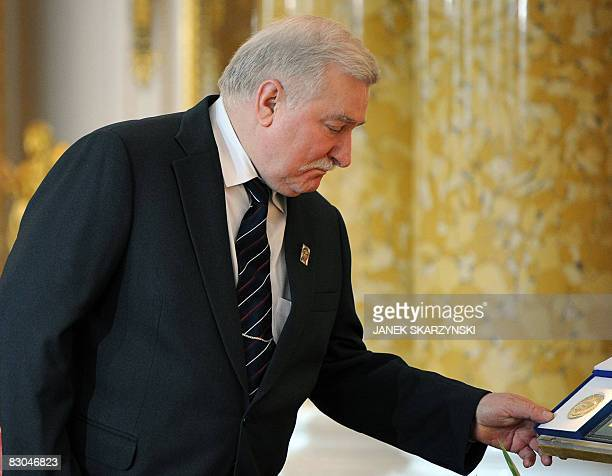 Poland's former Solidarity leader and expresident Lech Walesa looks at his Nobel prize medal which is normally kept in the Jasna Gora monastery in...