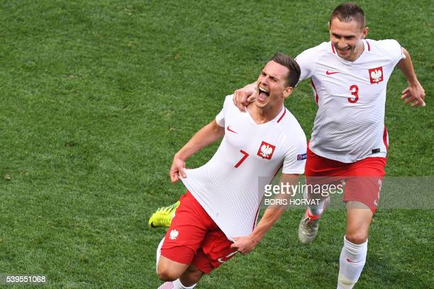 TOPSHOT Poland's forward Arkadiusz Milik celebrates after scoring a goal during the Euro 2016 group C football match between Poland and Northern...