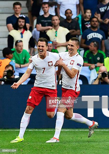 Poland's forward Arkadiusz Milik celebrates after scoring a goal during the Euro 2016 group C football match between Poland and Northern Ireland at...