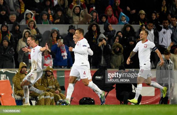 Poland's forward Arkadiusz Milik celebrates after shooting a penalty kick to score a goal during the international UEFA Nations League football match...