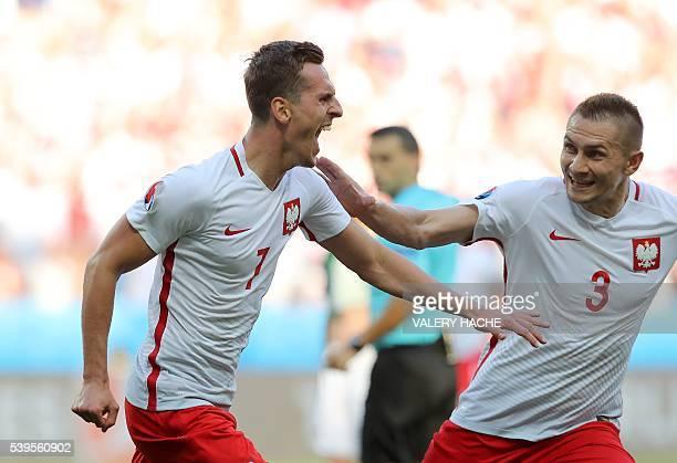 Poland's forward Arkadiusz Milik celebrates his goal with Poland's defender Artur Jedrzejczyk during the Euro 2016 group C football match between...