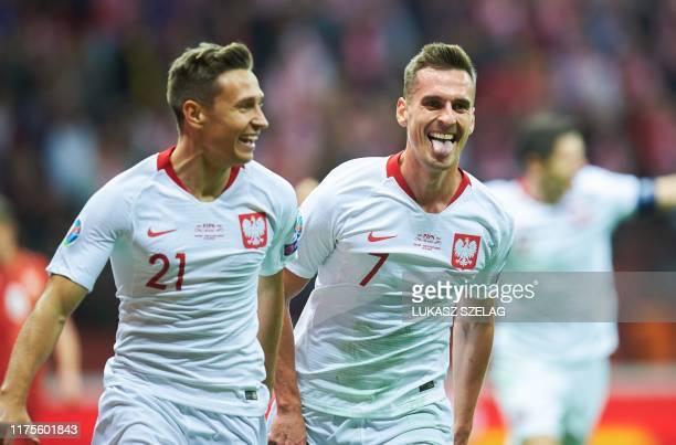 Poland's forward Arkadiusz Milik celebrates the opening goal by Poland's midfielder Przemyslaw Frankowski during the Euro 2020 qualifier Group G...