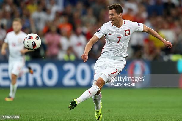 Poland's forward Arkadiusz Milik kicks the ball during the Euro 2016 quarterfinal football match between Poland and Portugal at the Stade Velodrome...