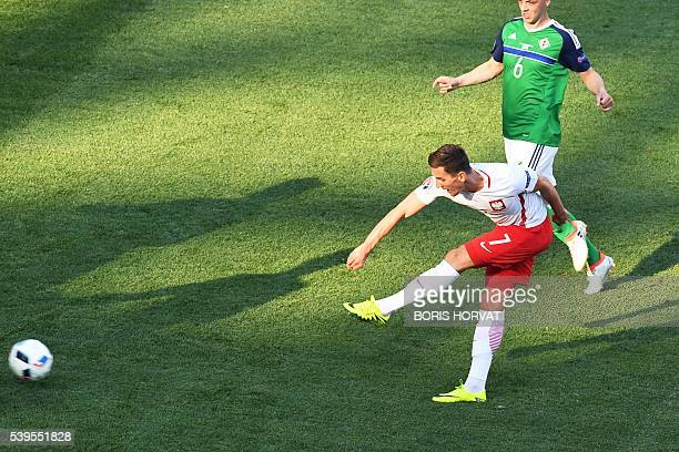 Poland's forward Arkadiusz Milik scores a goal during the Euro 2016 group C football match between Poland and Northern Ireland at the Stade de Nice...