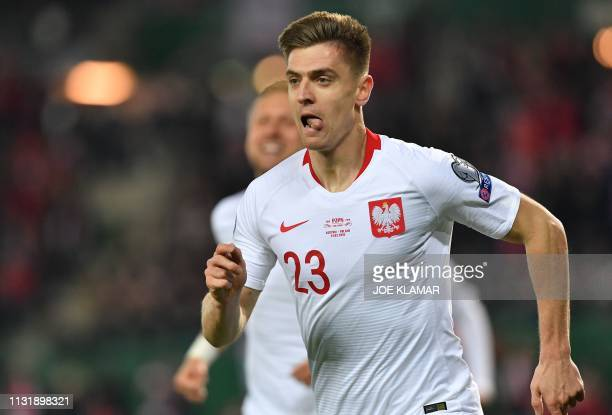 Poland's forward Krzysztof Piatek celebrates scoring the opening goal during the UEFA Euro 2020 Group B qualification football match between Austria...