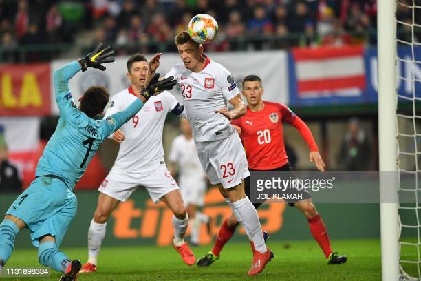 Poland's forward Krzysztof Piatek scores the opening goal past Austria's goalkeeper Heinz Linder during the UEFA Euro 2020 Group B qualification...
