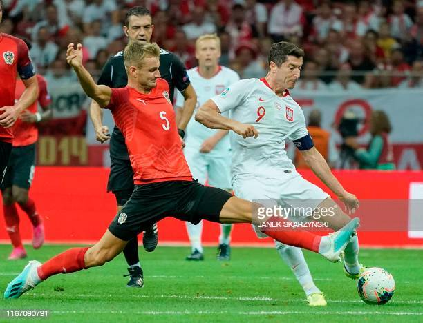 Poland's forward Robert Lewandowski and Austria's Defender Stefan Posch vie during the UEFA Euro 2020 Group G qualification football match Poland v...