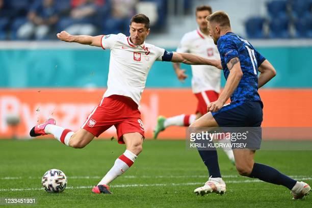 Poland's forward Robert Lewandowski and Slovakia's defender Milan Skriniar vie for the ball during the UEFA EURO 2020 Group E football match between...